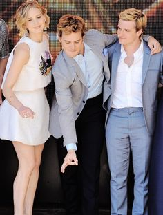 Jennifer Lawrence, Sam Claflin, and Josh Hurcherson. Mockingjay photo call in Cannes. May 17, 2014