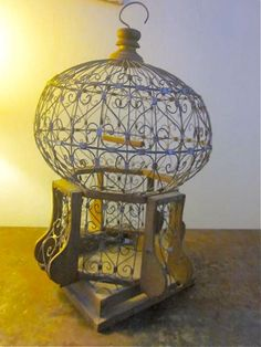 Antique French Wirework and Wood Dome Shaped Bird Cage. $160.00, via Etsy.