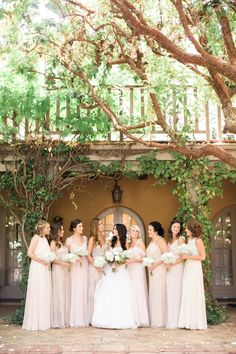 We adore this mix n' match neutral bridal party: http://www.stylemepretty.com/vault/gallery/38379 | Photography: Brittrene Photo - http://brittrenephoto.com/