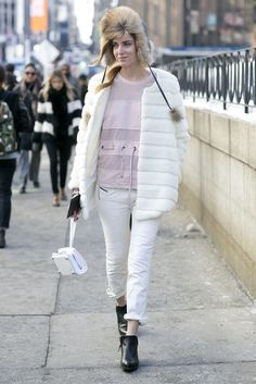 Chiara Ferragni's pastel pink and white could have been perfectly suited for Spring; but she topped it all off with a fur trapper that speaks entirely to Winter.   Source: Tim Regas