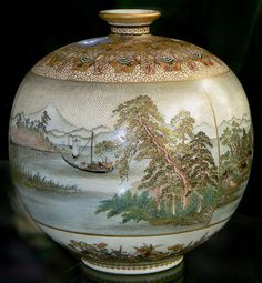 his is a truly fabulous Satsuma vase by Yabu Meizan. It is an earlier style from Yabu Meizan has three separate realistically painted landscapes of Lake Biwa that wrap all the way around the piece. There is such fine detail it is difficult to photograph. It is an amazing piece and great example from this most famous of the Japanese Satsuma workshops. The vase is finished off on the top shoulder area with extreme gold and enamel detailing. The vase stands 4 3/4 tall and 4 1/4 wide. The mate…