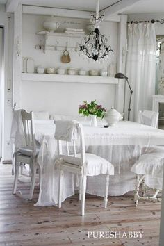 Beautiful white room.....I adore that chandelier too....
