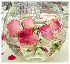 Rose water bowls!... give it more life by adding a goldfish, but make sure you take care of the little fish friend :) Place a few candles to the sides of the bowl to make it even more pretty!
