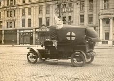 """July 18, 1922 """"This is NOT a Red Cross ambulance. From 1915 onwards the members of the Irish Automobile club modified their personal cars into ambulances at their own expense and ferried wounded Irish solders returning from the European hostilities to hospitals and convalescent homes around the country. When the Rising occurred they continued to carry the wounded from both sides to medical attention. At least one driver was shot in the process, happily without fatal consequences."""""""