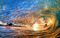 Clark Little, a surfer and photographer based in Hawaii, loves to get up close and personal with the sea and its power, taking breathtakingly beautiful photos from within powerful waves.
