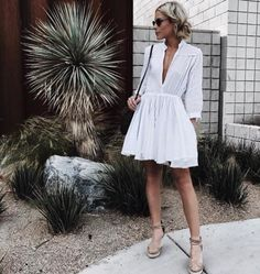 Try pairing a white dress with espadrille sandals and statement sunglasses for a feminine and sophisticated look.