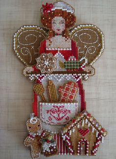 Cross Stitch Christmas ornament on plastic canvas
