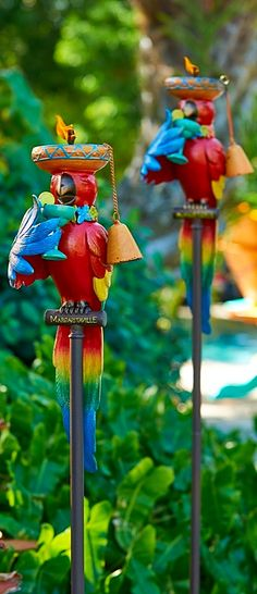 Constructed of aluminum and topped with a whimsical, feathery friend, this tropical torch adds color and light to your outdoor area.   Margaritaville by Frontgate