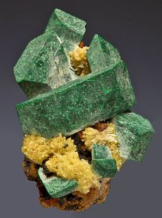 elongated crystals of green malachite with bright yellow mimetite