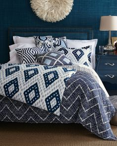 I love these textured navy walls in a John Robshaw bedding ad.