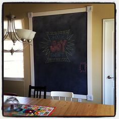 Chalkboard paint and molding // photo from Erin at Two More Seconds; would love to do this in the foyer with half chalkboard paint and half magnetic paint
