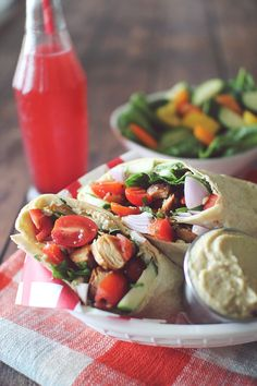 These Greek Chicken Hummus Wraps only have a few ingredients and take 10 minutes to make! They travel well too, which makes them an ideal lunch option!