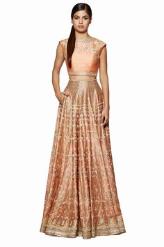 Presenting a beautiful fusion of contemporary and tradition with this crop top and cascading skirt in the warm hues of apricot. Pair it with studded earrings and a ring to take everyone's breath away.$172,000.00