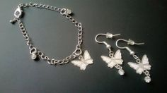 Bracciale e orecchini con farfalla e brillantino