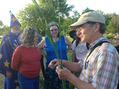 One timebank member leads other members on an edible plant walk, teaching how to identify and use wild edible plants. (Photo: Beverly Bell)