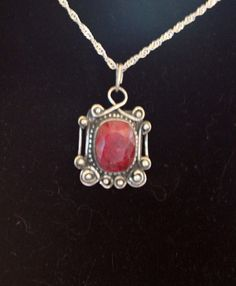 Natural ruby and sterling silver pendant