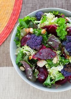Greens, Colored Cauliflower & Beet Salad with Quinoa, Almonds & Manchego Cheese #healthy #salad #recipe #suja #sujajuice #health #nutrition #juicecleanse #itsthejuice #detox #organic #wholefoods #nongmo