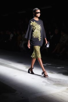 The winter to spring transition was an inspiring trend for the Dries Van Noten show, as evident by this black and green embellished look at Paris Fashion Week.