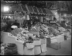 """""""A typical fruit and vegetable stand in Center Market, Washington, DC""""  By W. Pack, February 18, 1915"""