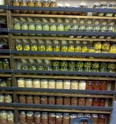Boards across the front of storage shelves will prevent glass canning ars from falling. Also prevents small children from pulling heavy jars down on top of their heads!