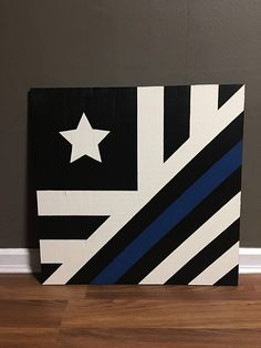 This 2x2 Police Flag Barn Quilt is a hand painted item. All of my barn quilts are primed and painted with the best exterior paint. Each quilt is 15/32 in depth. This police flag barn quilt is made of blue, black, and white paint. Can be made in different sizes, just ask! Barn Quilts