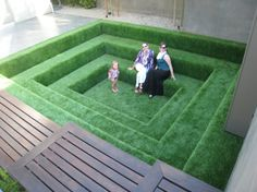 Lisa Ling's house -   Lori, Sara and Elle took the opportunity to enjoy the Conversation Pit covered in faux Grass.  http://www.loridennis.com/greenblog/2012/06/interior-design-house-tour-with-lisa-ling-and-paul-song/