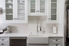 We're swooning over this kitchen re-design. Get the white backsplash look with our AquaTile panels: http://www.decpanels.com/products/aquatile #kitchen #white #classic