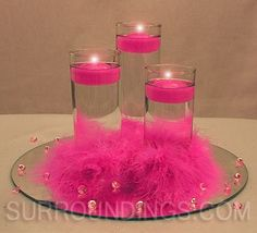 Feather cuffs on small cylinders with diamonds and round centerpiece mirror candle centerpiece