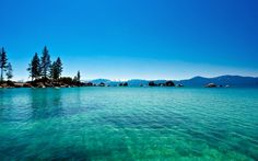 Lake Tahoe, California & Nevada, USA  An enormous lake surrounded by evergreens and relaxing scenery.