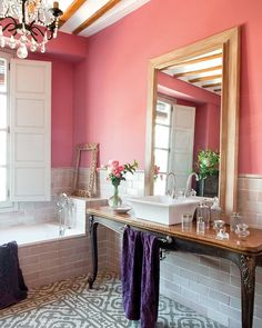 A splash of pink warms up a white bathroom - follow us on www.birdaria.com like it love it share it click it pin it!!!