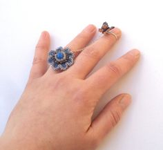 Butterfly flying fom a flower double ring two by otherworlds, $40.00