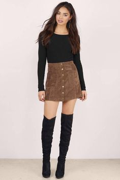 Be a retro mega-babe in the American Woman Faux Suede Skirt. This A-line mini skirt is made from a soft faux-suede fabric and features button closures - Fast & Free Shipping For All Orders!
