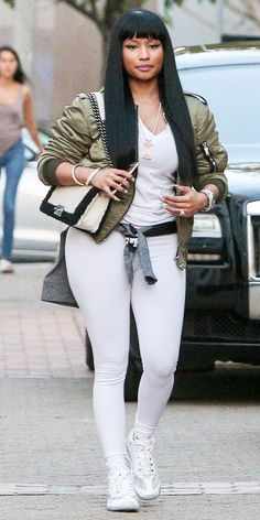 Nicki Minaj broke up her casual white separates with an army green bomber.