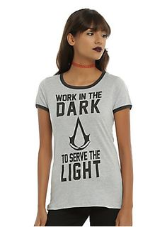 """Laa shay'a waqui'n moutlaq bale kouloun moumkine. The wisdom of our Creed is revealed through these words. We work in the dark to serve the light. We are Assassins. Nothing is true, everything is permitted.""<br><br>Grey ringer style tee from <i>Assassin's Creed</i> with the Ezio Auditore quote screened on the front. Black trim.<br><ul><li style=""LIST-STYLE-POSITION: outside !important; LIST-STYLE-TYPE: disc !important"">90% cotton; 10% polyester</li><li style=""LIST-STYLE-POSITION: outside…"