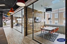 Rustic Office Design with Industrial Pendant lighting and Tree Sculpture