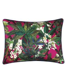 Christian Lacroix Canopy Grenade Cushion. A dynamic, luxurious cushion from the design house of Christian Lacroix, featuring colourful tropical flora and fauna printed onto cotton sateen, reversing to a bold black and cobalt blue striped silk reverse. The design also includes fine embroidery across the front picking out some of the leaves.