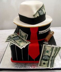 White cake with 2 different layers of filling-apricot and dulce de leche on each layer--it was delicious!! Covered in white chocolate ganache and fondant. Hat is RKT, cigar and tie is gumpaste and edible images for the $$.