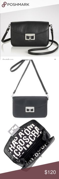 """Marc by Marc Jacobs cross body bag brand new This pebbled leather Marc by Marc Jacobs bag features a cutout logo plate and a turn-lock closure at the front flap. Silver hardware. Detachable shoulder strap. Lined interior features 6 card slots.  * 5""""H x 8""""L x 1.5""""D. * 21"""" strap drop. * Leather: Cowhide. * Weight: 8 oz / 0.23 kg. * Imported. Marc by Marc Jacobs Bags Crossbody Bags"""