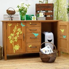 Use colourful stickers to add a personal touch to a country-style oak cupboard — a storage space large enough to hide away the shredder