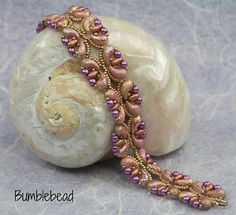 This pretty bracelet can be made with Zoliduos or only Superduos. The tutorial explains how to make the bracelet through detailed step by step instructions, supported by clear step by step photography. You will need: Zoliduos (optional), superduos, 3mm pearls, size 15 miyuki seed beads, wire guardians, jumprings, a lobster clasp, a beading needle and 6lb or 4lb fireline. I am happy for you to sell items made using the tutorial locally, in galleries and at local craft fairs. I do not permit…