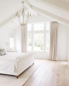 bedroom vaulted ceiling chandelier hardwood floors restoration hardware benjamin moore simply white rugsusa