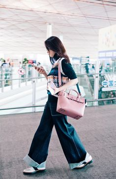 554a4b444afaa Actress  VivienLi wears the small  TheBeltBag with a  Burberry scribble  check vest and