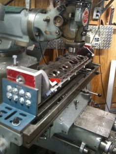 Cylinder Head Milling Fixture by lbhsbz -- Homemade cylinder head milling fixture constructed from commercially-available angle plates, a surplus crankshaft, and surplus steel stock. http://www.homemadetools.net/homemade-cylinder-head-milling-fixture