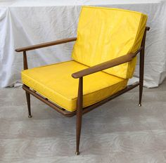"Mid Century 1950's faux wood lounge chair marked Viko Furniture. The ""wood"" is actually metal, so with the vinyl cushion, this chair would work inside or out."