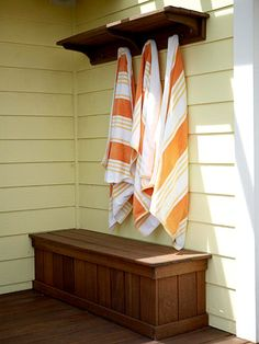 Hide and Sit.... great for the dog toys and garden tools. Love this idea! it would be great by the hot-tub.