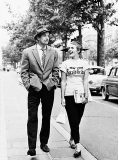 Jean-Paul Belmondo and Jean Seberg on the set of 'A Bout de Souffle', photographed by Raymond Cauchetier, Paris, 1959.