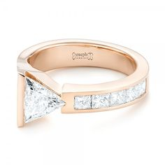 This stunning engagement ring features a trillion diamond asymmetrically bar set, with channel set princess cut diamond accents along the top of the rose gold band. Designed and created by Joseph Jewelry Three Stone Engagement Rings, Diamond Engagement Rings, Trillion Engagement Ring, Trillion Ring, Solitaire Rings, Bijoux Or Rose, Finger, Pear Shaped Diamond, White Gold Rings