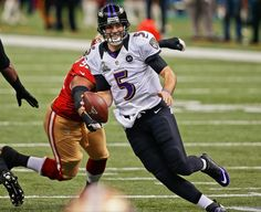 Baltimore Ravens quarterback Joe Flacco (5) runs out of the pocket as San Francisco 49ers defensive end Ray McDonald NFL Super Bowl XLVII