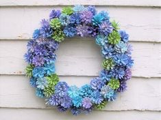 Unique wreath with painted Pine cones in purples, blues, white, and green Pine Cone Wreath Hydrangea-inspired. Unique wreath with Pine Cone Art, Pine Cone Crafts, Pine Cones, Pine Cone Flower Wreath, Nature Crafts, Fall Crafts, Diy And Crafts, Paper Crafts, Wire Wreath Forms