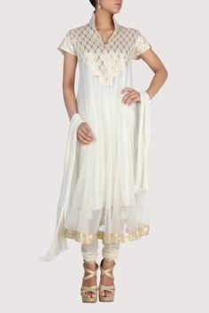 White suit has a tinge of ivory tone and metallic finish which lends an elegant finish to the outfit. Shop Now: www.karmik.in/shopping/index.php